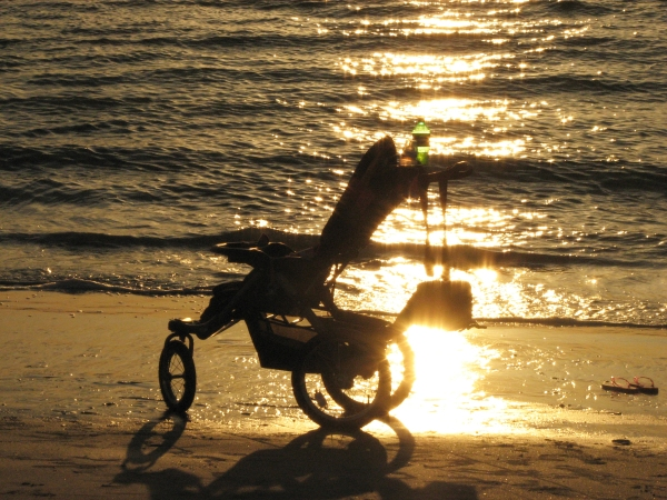 A stroller on sunset beach by Tiny