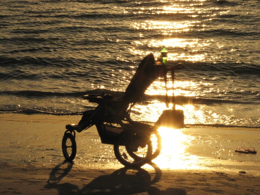 A stroller on sunset beach by Tiny