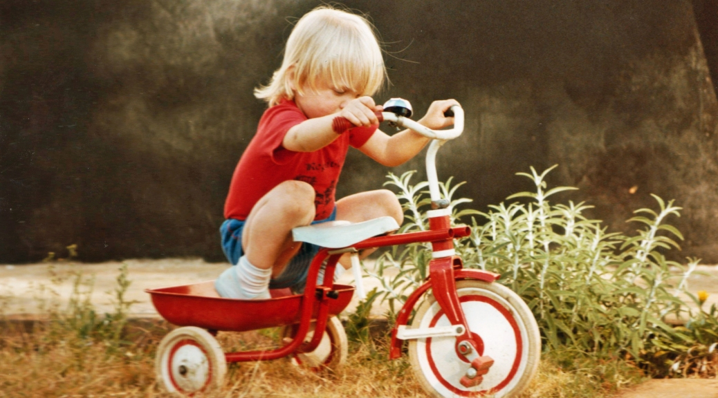 baby with tricycle