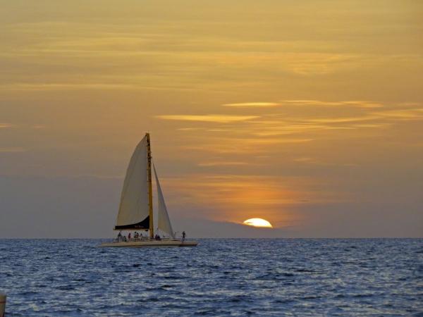 sailing boat at sunset Gulf Beach