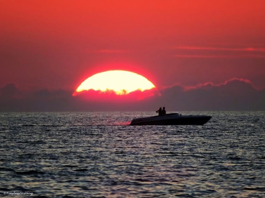 boat at sunset on Halloween sand key