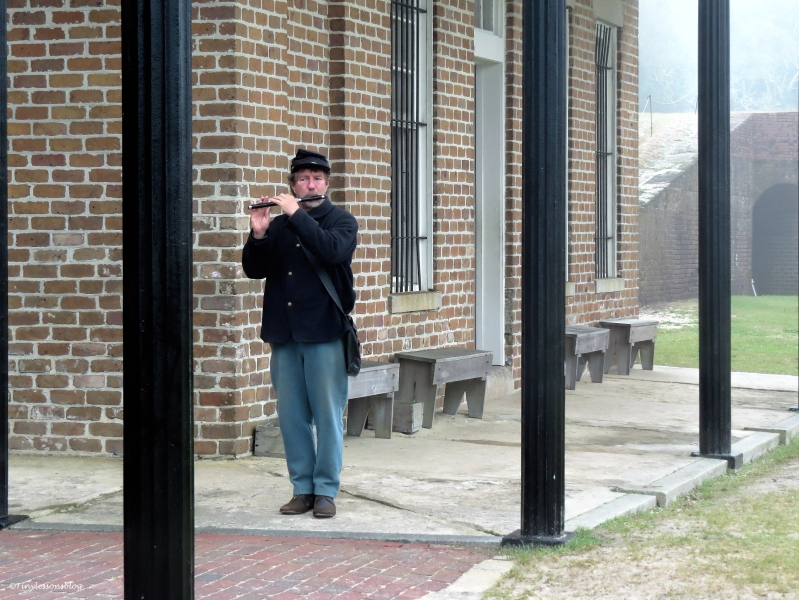 union soldier plays flute at fort clinch