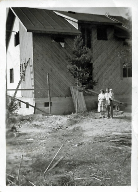 Our house being built. Here mom, dad and me.