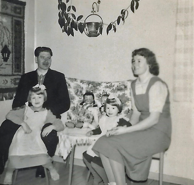 sisters and parents in the play corner